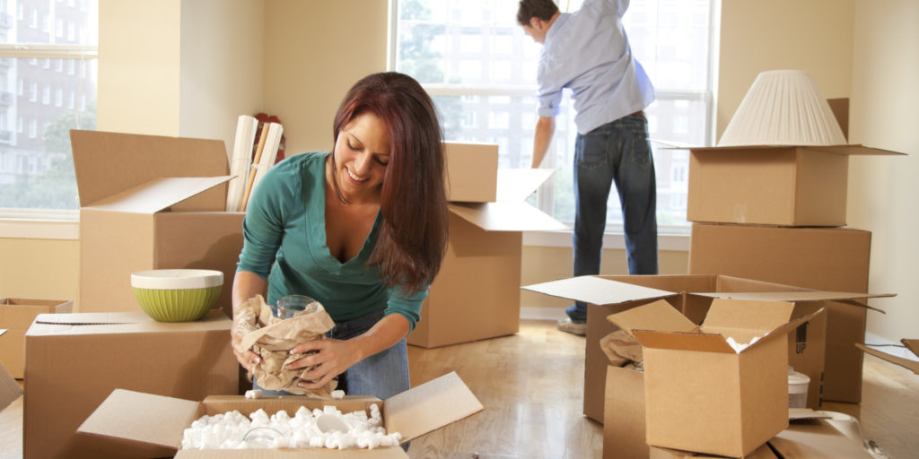image of people unpacking boxes after a move in shertz
